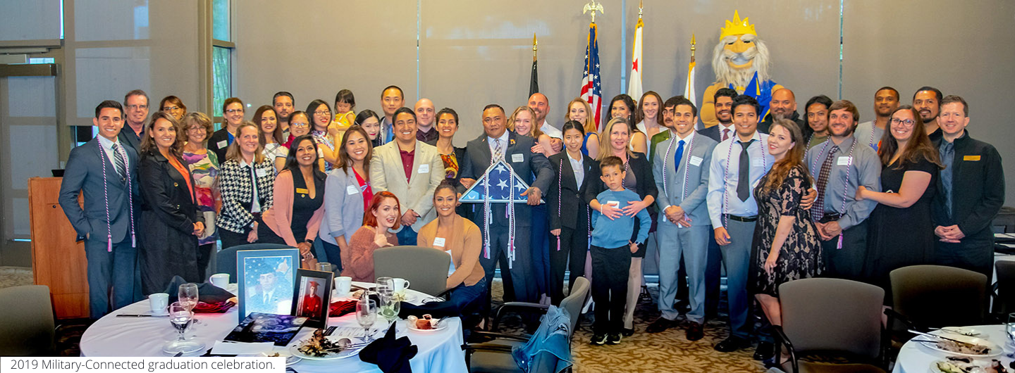 UC San Diego Student Veterans Resource Center - group photo of graduates and friends and family at 2019 graduation celebration