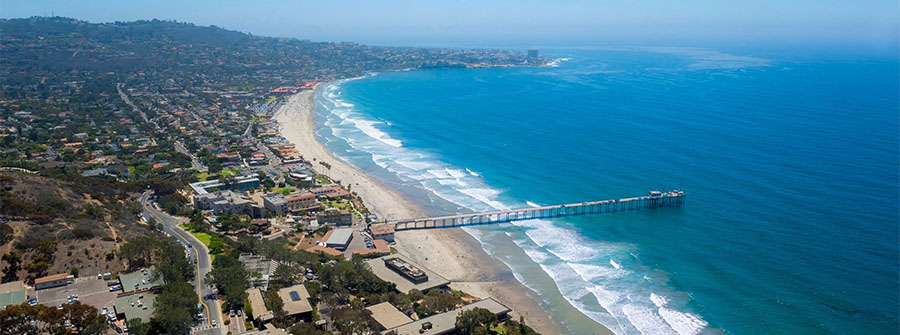 Aerial view of Scripps Pier and La Jolla coastal community surrounding UC San Diego